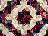 Green and Burgundy Split Nine Patch Quilt