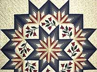 King Navy and Burgundy Eight Point Wreath Quilt