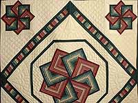 Green and Burgundy Star Spin Quilt