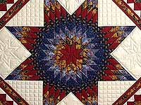 Gold Blue and Red Lone Star Trip Quilt