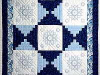 Blue and Ivory Log Cabin Cross Stitch Quilt