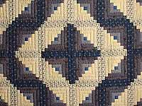 Blue and Tan Log Cabin Quilt