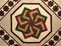 Green Burgundy and Tan Star Spin Quilt