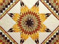 Gold Red and Moss Lone Star Trip Quilt