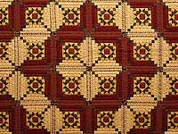 Burgundy Gold and Green Stars in the Cabin Quilt