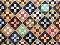 Blue Tan and Multicolor Scrappy Nine Patch Quilt