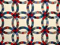 Red Navy and Multicolor Double Wedding Ring Quilt