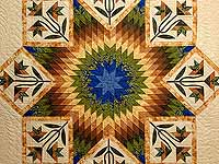 Blue Gold and Green Flowering Star Quilt