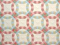 Pastel Pink and Blue Double Wedding Ring Quilt