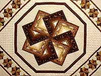 Brown and Gold Star Spin Quilt