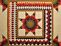 King Fire Red Green and Gold Star Quest Quilt