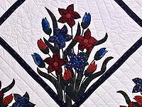 Full Size Blue and Red Appliqué Lilly Quilt