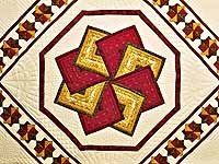 Green Burgundy and Gold Star Spin Quilt