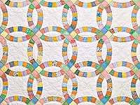 King Pastel Extra Fine Double Wedding Ring Quilt
