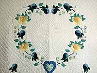 Blue and Yellow Heart of Roses Quilt