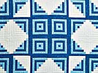 Blue and Cream Log Cabin Star Quilt