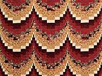 Burgundy and Golden Tan Bargello Quilt