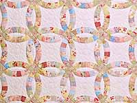 Antique Pastels Double Wedding Ring Quilt
