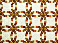 Brown Rust Sage and Gold Double Wedding Ring Quilt