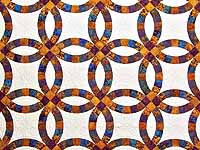 Gold Purple and Blue Batik Double Wedding Ring Quilt