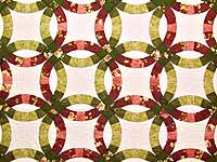 Red and Moss Green Double Wedding Ring Quilt