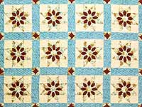 Pastel Blue and Dark Burgundy Dahlia Star Quilt