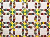 Yellow Green and Multicolor Double Wedding Ring Quilt