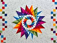 Multicolor Cartwheel Compass Quilt