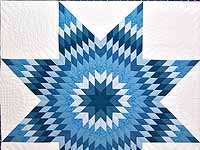 Blue and Cream Star of Bethlehem Quilt