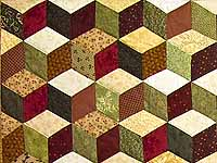 Green Gold and Red Tumbling Blocks Quilt