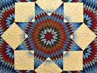 Blue and Burgundy Broken Star Quilt