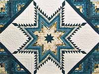 Watery Blue and Gold Feathered Star Log Cabin Quilt