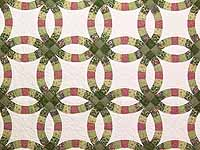 Green and Rose Double Wedding Ring Quilt