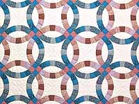 Blue and Rose Double Wedding Ring Quilt