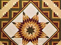 Burgundy Moss and Golden Tan Lone Star Log Cabin Quilt