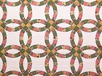 Green Rose and Tan Double Wedding Ring Quilt