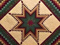 Bugundy and Teal Feathered Star Trip Quilt