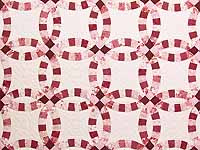 Scarlet and White Double Wedding Ring Quilt