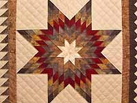 Fire Red Gold and Brown Star Quest Quilt