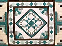King Teal and Brown Flying Geese Log Cabin Medallion Quilt