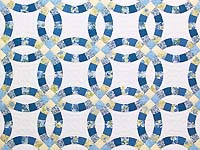 Blue and Yellow Double Wedding Ring Quilt