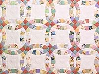 King Pastel Double Wedding Ring Quilt