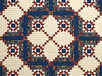Blue Rust and Ivory Star in the Cabin Quilt