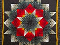 Black Red and Pewter Tumbling Star Quilt