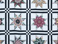Black and Multicolor Stack and Whack Stars Quilt