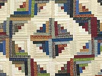 King Burgundy and Multicolor Bear Mountain Log Cabin Quilt