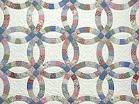 Pink Blue and Multicolor Double Wedding Ring Quilt