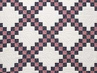 Twin Rose Black and Cream Irish Chain Quilt