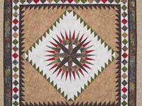 Gold Red and Moss Mariner's Compass Quilt