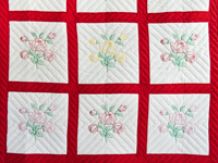 Red and White Embroidered Roses Quilt